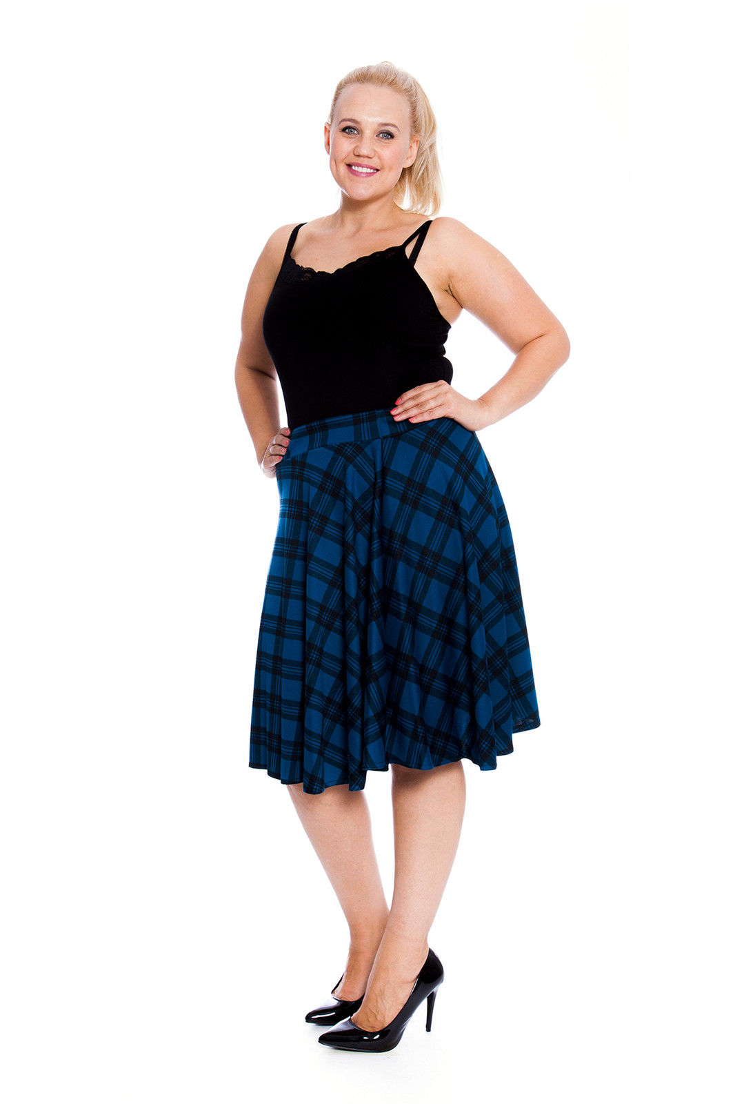 Tartan is a big hit right now, and this knee length tartan skirt is this seasons must-have. Made from a soft, stretch fabric and an elasticated waist it is both comfortable and easy to wear. Team up with over-sized knits for a cosy autumn/winter look, or wear it with an edge and pair it .